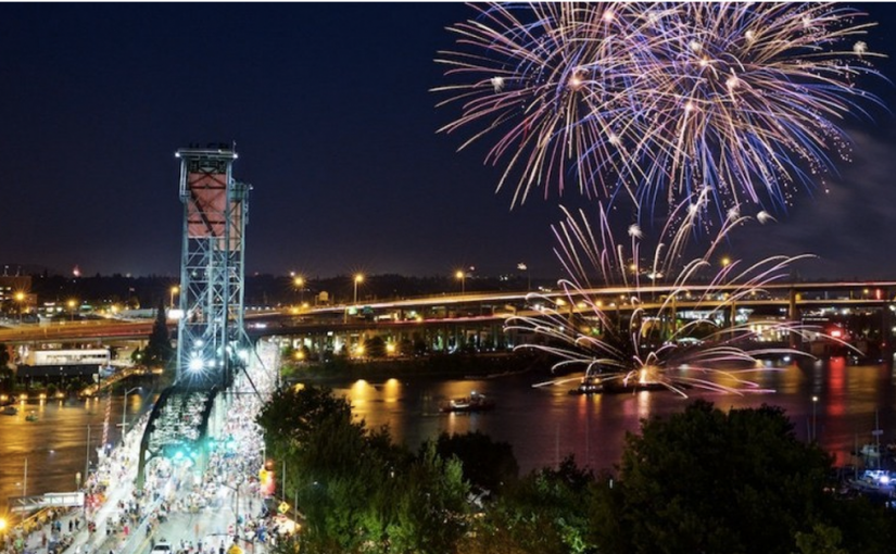 Fireworks Above The River, Steel Bridge Glistening With Traffic In Foreground